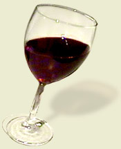 A tipsy glass of red wine